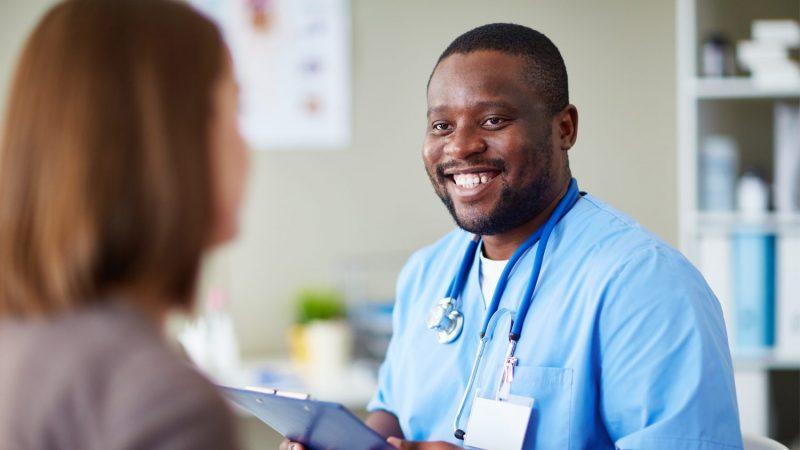 smiling nurse with patient